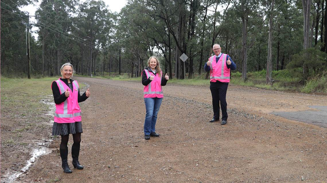 Council's General Manager Lotta Jackson, alongside Engineer Renae Leayr and Mayor Pynsent at Old Maitland Road