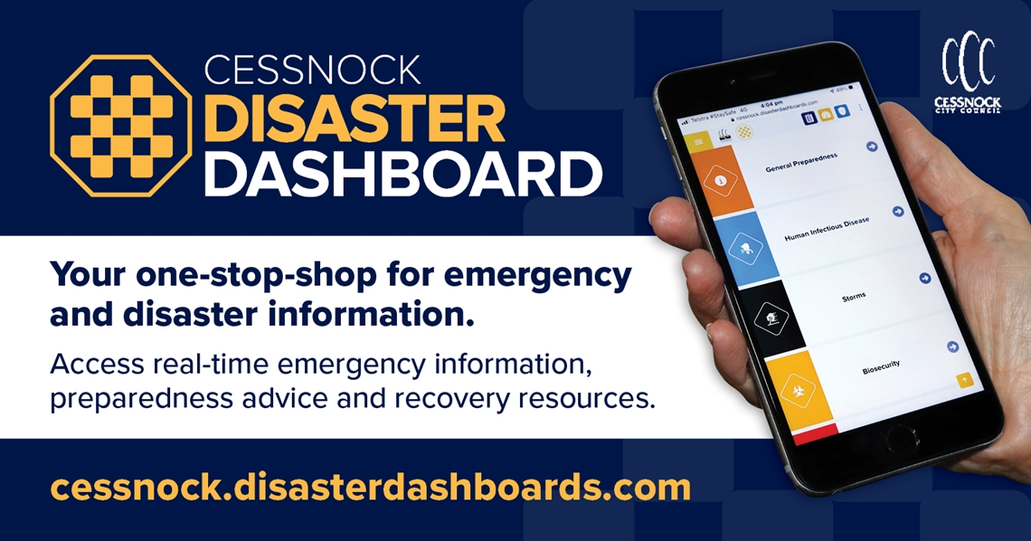 Photo of hand holding a phone with the Cessnock Disaster Dashboard open in a web browser