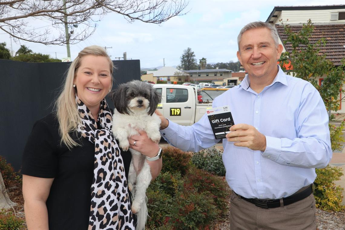 Owner Emily with her winning pooch Olive and Principal Ranger Jason presenting the gift card